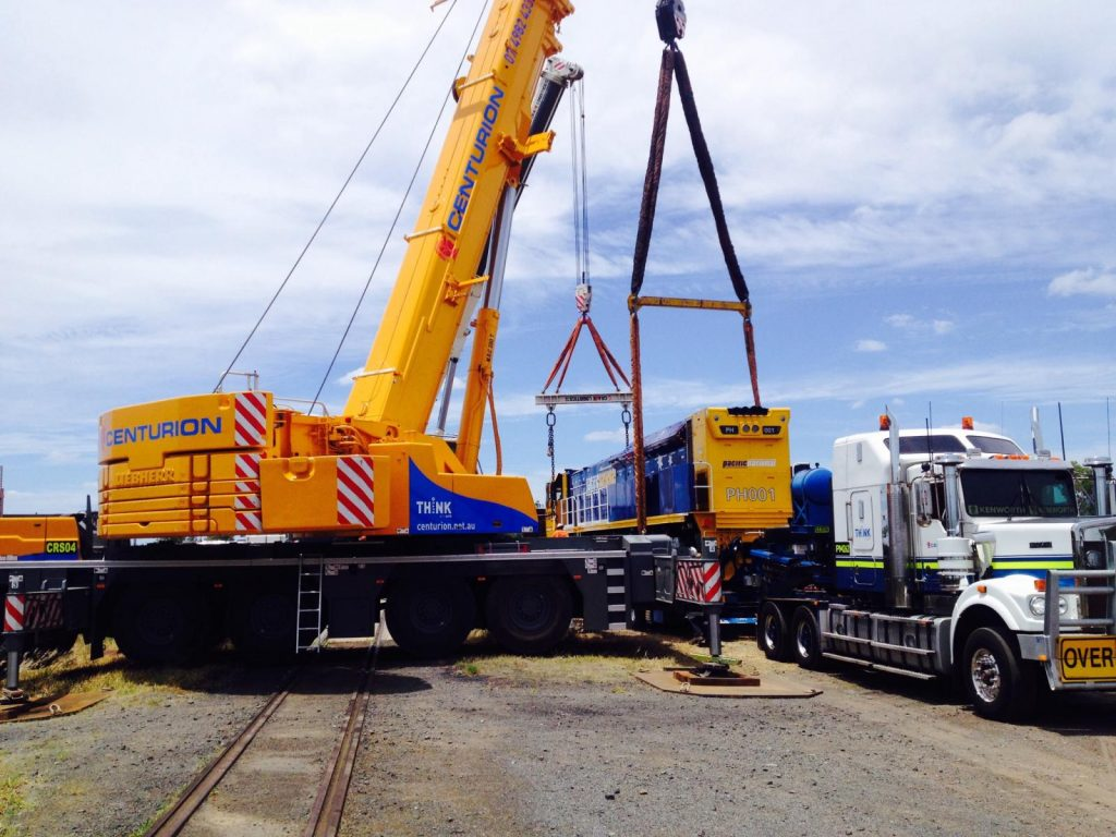 Centurion crane performing lift and shift rigging services in Queensland.