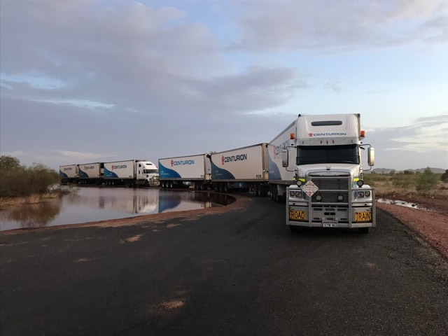 A convoy of trucks waiting for the roads to open south of Kununurra after cyclone Veronica in March 2019